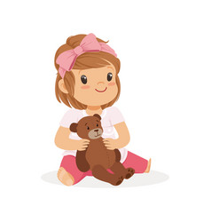 Adorable little girl playing with teddy bear vector