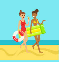 Two young women walking on the beach holding vector