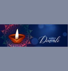 beautiful diwali festival blue banner with diya vector image