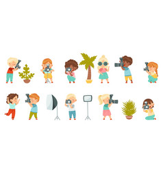Cute little boy and girl with camera taking vector