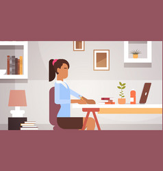 Indian business woman sitting desk working vector