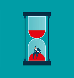 Businessman in hourglass vector