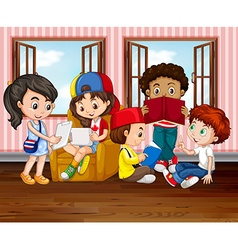Children reading books in room vector image