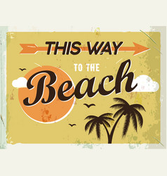 Grunge retro metal sign this way to beach vector
