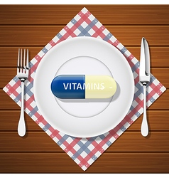 fork with knife and vitamin capsule on white plate vector image