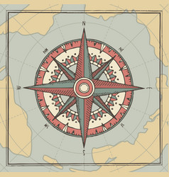Travel banner with a wind rose and old compass vector