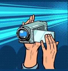 Portable hand-held video camera vector