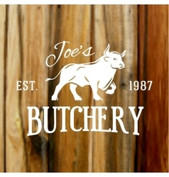 Premium vintage beef bull label on blurred wood vector image vector image