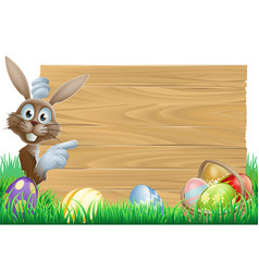 Easter bunny pointing at sign vector
