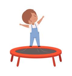 Cute boy bouncing on a trampoline kid vector