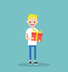 Young happy blond boy holding a bright gift box vector