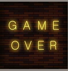 glass neon game over sign on solid red brick wall vector image