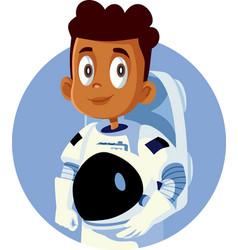 Little boy wearing an astronaut costume vector