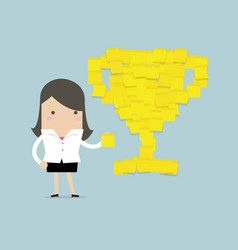 Businesswoman with trophy cup yellow sticky notes vector