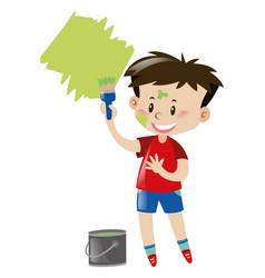 Little boy painting wall green vector