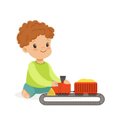 Sweet little boy playing playing with toy railway vector