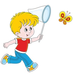 Boy catching a butterfly vector image