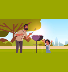 father and daughter preparing hot dogs on grill vector image
