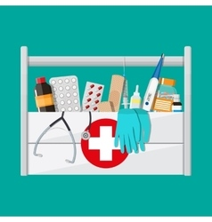 First aid kit with pills and medical devices vector image