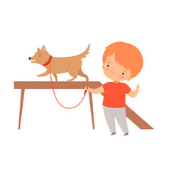 Little boy training his dog isolated on white vector