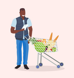 African american man checking shopping list happy vector