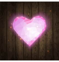 Polygonal pink heart on wooden texture vector