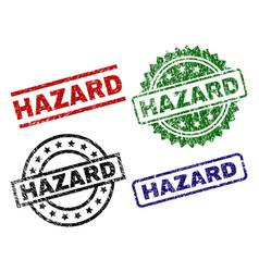 Scratched textured hazard stamp seals vector