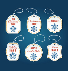 christmas sale tags on blue background vector image