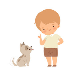 Little boy teaching his dog some tricks isolated vector