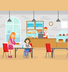 two girls friends eating desserts at table in cafe vector image