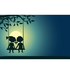 Moonlight silhouettes of a boy and girl vector