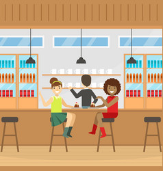 Two smiling woman sitting at bar counter eating vector