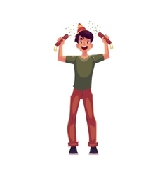 Young man in birthday hat with party poppers in vector