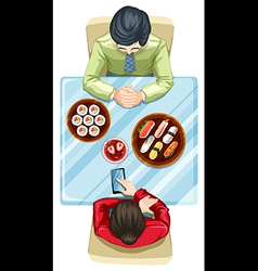 A topview of two people eating sushi vector