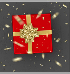a realistic red gift box decorated with a gold bow vector image