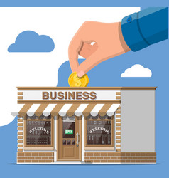 shop building commercial property hand with coin vector image