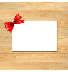 Red Bow And Blank Gift Tag With Wooden Wallpaper vector