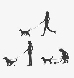 Silhouette of woman walking a dog vector
