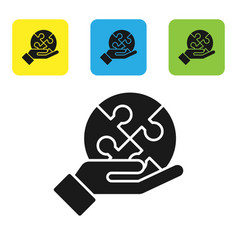 Black piece puzzle in hand icon isolated on vector