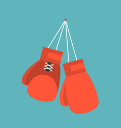 red boxing gloves hanging on nail of wall vector image