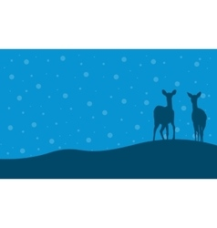 Silhouette of two deer in hill scenery vector