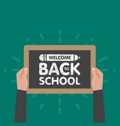 Hand holding sign back to school chalkboard vector