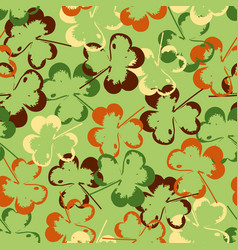 seamless texture of leaves on green background vector image