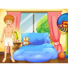 A boy inside his room with a robot and a vector