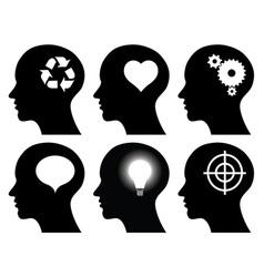 black head profiles with idea symbols vector image vector image