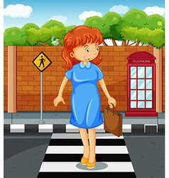 Woman crossing the road vector