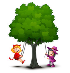 Halloween kids costumes play under the tree vector