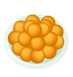 A Dish of Deep Fried Sweet Potato Balls vector