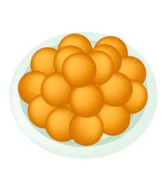A Dish of Deep Fried Sweet Potato Balls vector image