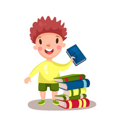 Smiling curly boy standing next to a pile of books vector